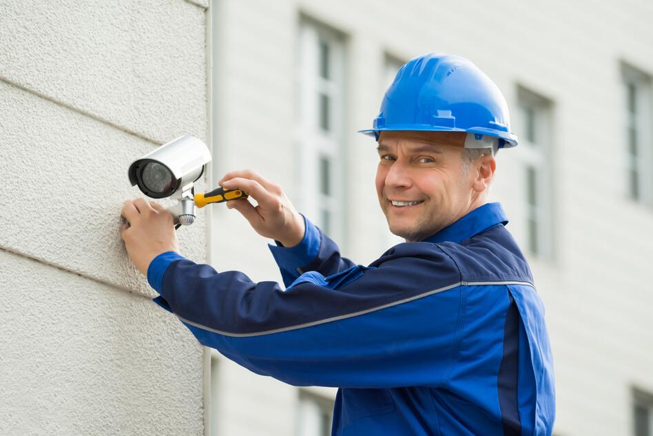 technician-installing-camera